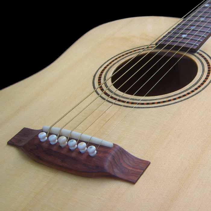 D-style acoustic guitar bridge