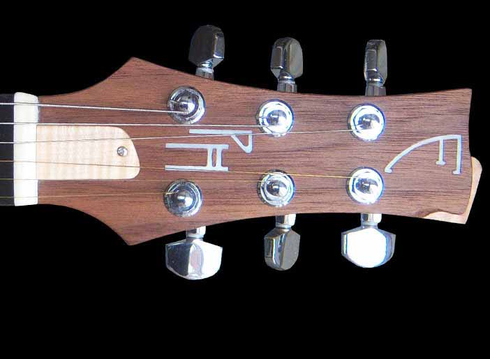 Custom-1 electric guitar head with pearl inlay