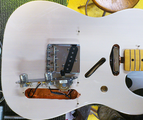 electronics and hardware are placed back in the telecaster body
