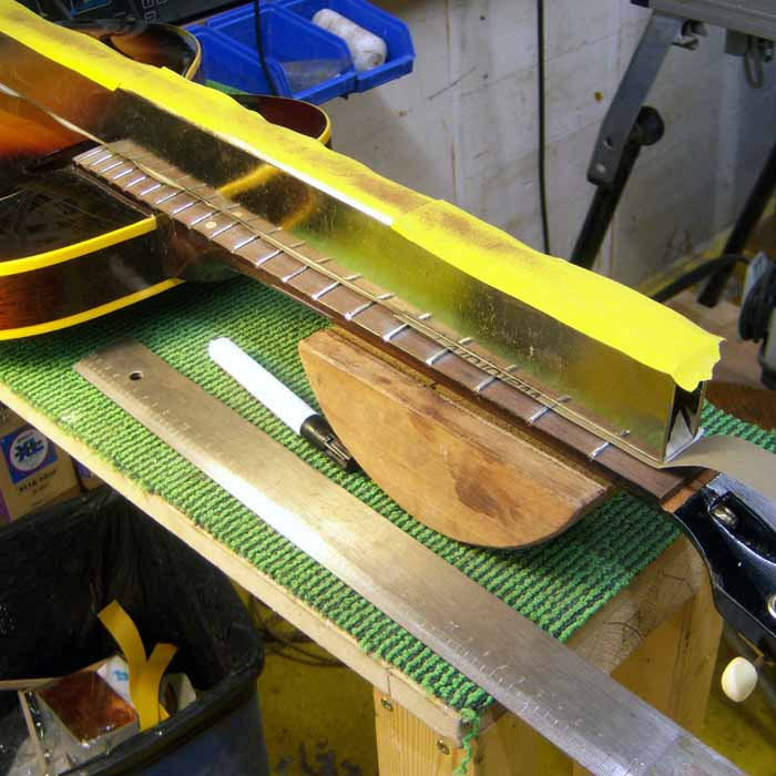 the frets are leveld with sandpaper