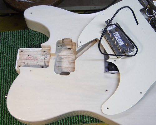 the humbucker is mounted in the pickguard