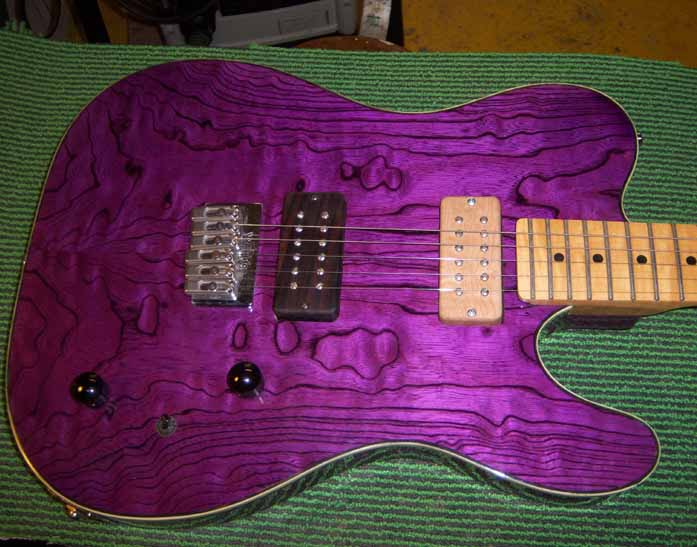 purple telecaster with wooden pickup covers
