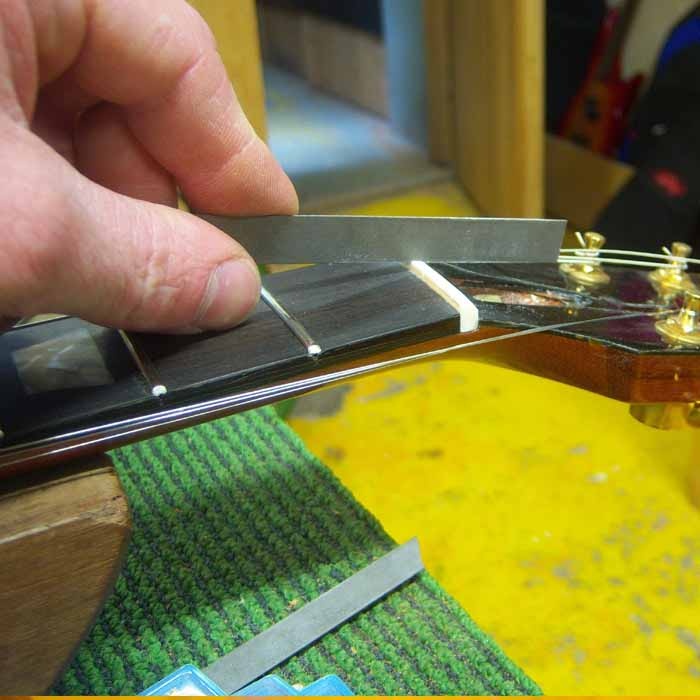 cutting the string slots in the bone nut